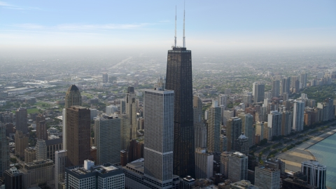 AX0001_039.0000055F - Aerial stock photo of A view of of John Hancock Center skyscraper, Downtown Chicago, Illinois