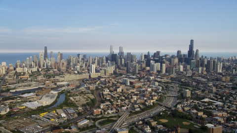 AX0001_063.0000122F - Aerial stock photo of The Downtown Chicago skyline seen from the west, on a hazy day, Illinois