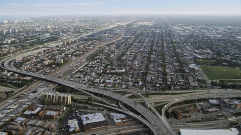 AX0001_075.0000122F - Aerial stock photo of The Interstate 90, 94, and 55 interchange and urban neighborhoods, South Chicago, Illinois
