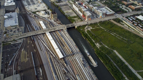 AX0001_078.0000000F - Aerial stock photo of Metra Railroad Yard and Chicago River, Downtown Chicago, Illinois