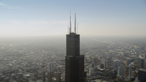 AX0001_082.0000000F - Aerial stock photo of The top of Willis Tower in Downtown Chicago, on a hazy day, Illinois