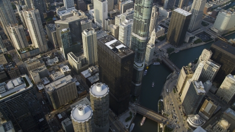 AX0001_084.0000110F - Aerial stock photo of A bird's eye of Marina City and Chicago River skyscrapers, Illinois