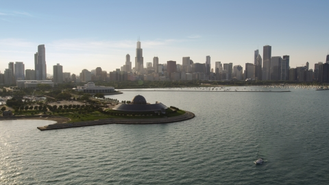 AX0001_099.0000279F - Aerial stock photo of Adler Planetarium and Downtown Chicago skyline seen from Lake Michigan, Illinois