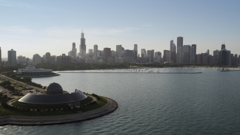 AX0001_100.0000050F - Aerial stock photo of The downtown skyline and harbor seen from Adler Planetarium, Downtown Chicago, Illinois