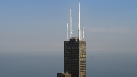 AX0001_110.0000062F - Aerial stock photo of The spires on top of Willis Tower in Downtown Chicago, Illinois