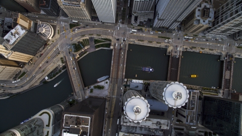 AX0001_137.0000181F - Aerial stock photo of A bird's eye view of N State Street in Downtown Chicago, and the Chicago River, Illinois