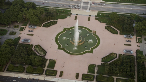 AX0001_150.0000223F - Aerial stock photo of A plume of water at Buckingham Fountain, Grant Park, Downtown Chicago, Illinois