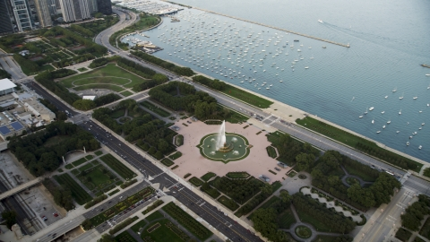 AX0001_151.0000000F - Aerial stock photo of The Buckingham Fountain in Grant Park near boats in the harbor, Downtown Chicago, Illinois