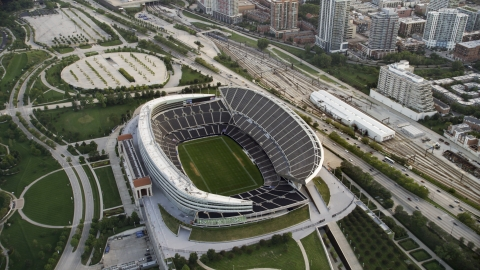 AX0001_152.0000154F - Aerial stock photo of Empty field and stands at Soldier Field football stadium, Chicago, Illinois