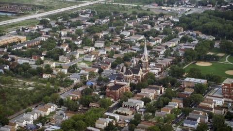 AX0001_160.0000028F - Aerial stock photo of Urban neighborhood and St. Michael Catholic Church, Chicago, Illinois