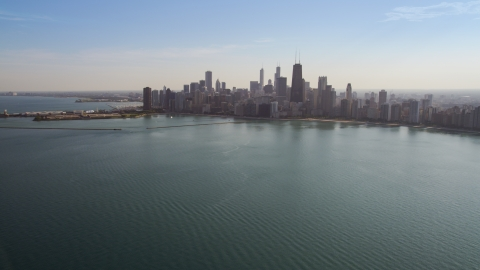 AX0002_018.0000304F - Aerial stock photo of The Downtown Chicago skyline, seen from Lake Michigan, Illinois
