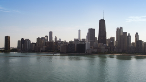 AX0002_020.0000312F - Aerial stock photo of A view of the city's skyline from Lake Michigan, Downtown Chicago, Illinois
