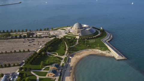 AX0002_085.0000202F - Aerial stock photo of The Adler Planetarium and Astronomy Museum by Lake Michigan in Chicago, Illinois