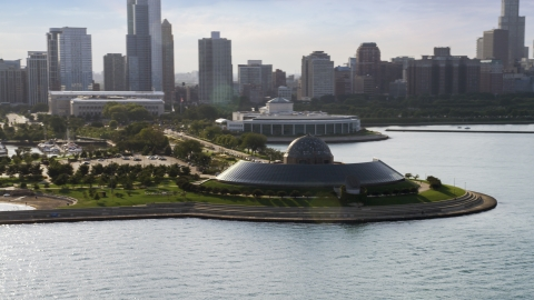AX0002_087.0000041F - Aerial stock photo of The Adler Planetarium and Astronomy Museum, Downtown Chicago in the background, Illinois