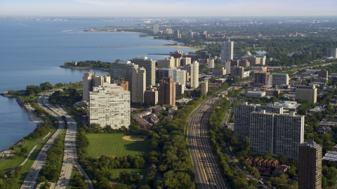AX0002_093.0000389F - Aerial stock photo of Waterfront apartment buildings in Hyde Park, Chicago, Illinois