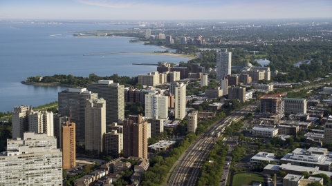 AX0002_094.0000243F - Aerial stock photo of Hyde Park apartment buildings overlooking Lake Michigan, Chicago, Illinois