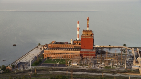 AX0003_010.0000227F - Aerial stock photo of State Line Generating Plant at sunset, Hammond, Indiana