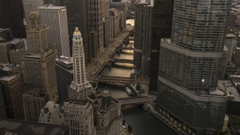 AX0003_038.0000097F - Aerial stock photo of The Chicago River between Mather Tower and Trump Tower at sunset, Downtown Chicago, Illinois
