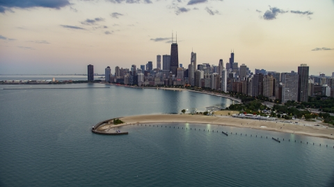 AX0003_072.0000303F - Aerial stock photo of North Avenue Beach and Downtown Chicago skyline at twilight, Illinois