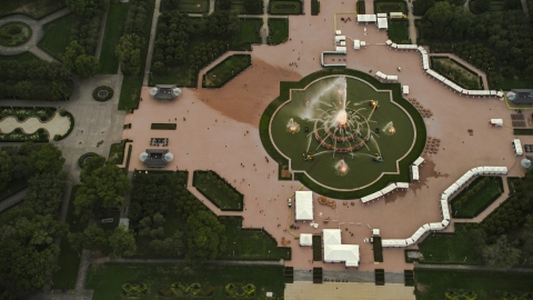 AX0003_082.0000071F - Aerial stock photo of Buckingham Fountain in Grant Park, at twilight, Downtown Chicago, Illinois