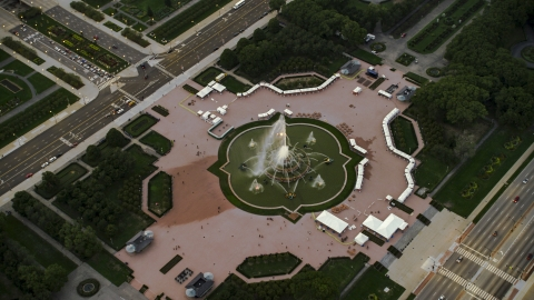 AX0003_082.0000264F - Aerial stock photo of Buckingham Fountain at twilight in Grant Park, Downtown Chicago, Illinois