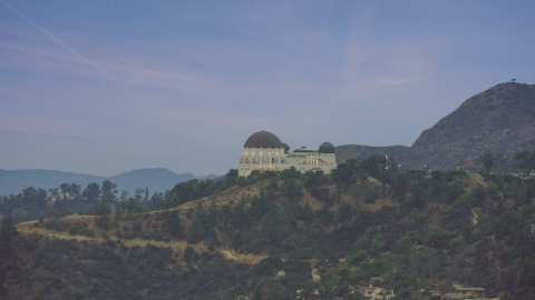 AX0158_007.0000416 - Aerial stock photo of Griffith Observatory at twilight in Los Angeles, California