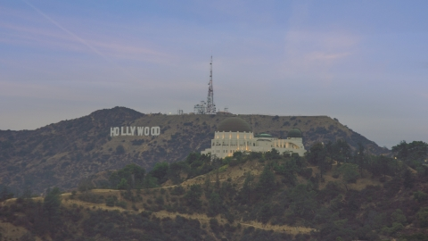 AX0158_008.0000386 - Aerial stock photo of Griffith Observatory and Hollywood Sign at twilight, Los Angeles, California