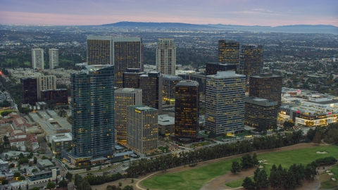 AX0158_024.0000157 - Aerial stock photo of Office buildings and skyscrapers at twilight, Century City, California