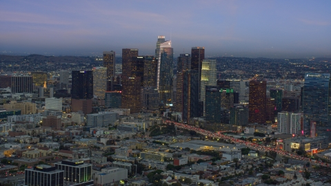 AX0158_044.0000179 - Aerial stock photo of Downtown Los Angeles skyline with new skyscraper, Wilshire Grand Center, twilight, California