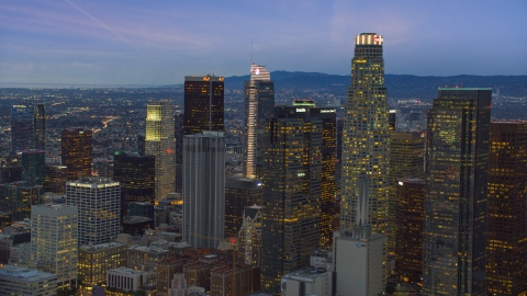 AX0158_048.0000259 - Aerial stock photo of A group of skyscrapers at twilight in Downtown Los Angeles, California