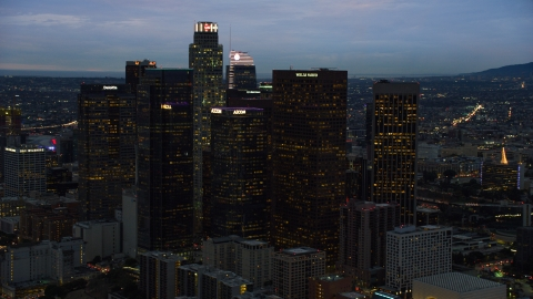 AX0158_049.0000209 - Aerial stock photo of Skyscrapers at twilight in Downtown Los Angeles, California
