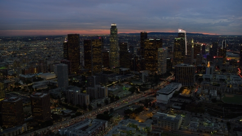 AX0158_051.0000214 - Aerial stock photo of Tall skyscrapers at twilight in Downtown Los Angeles, California