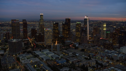 AX0158_052.0000310 - Aerial stock photo of A view of skyscrapers at twilight in Downtown Los Angeles, California
