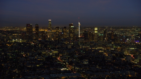 AX0158_072.0000199 - Aerial stock photo of The tall towers of the Downtown Los Angeles skyline, California at night
