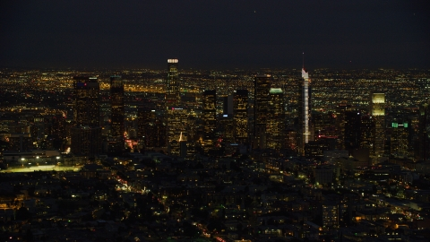 AX0158_073.0000309 - Aerial stock photo of The Downtown Los Angeles skyline at night, California