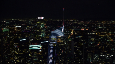 AX0158_113.0000337 - Aerial stock photo of The top of Wilshire Grand Center at night in Downtown Los Angeles, California