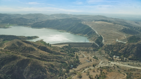 AX0159_160.0000213 - Aerial stock photo of Irvine Lake and Santiago Dam, Orange, California