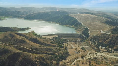 AX0159_161.0000000 - Aerial stock photo of A dam and Irvine Lake, Orange, California