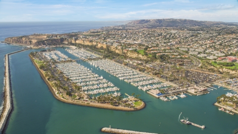 AX0159_188.0000346 - Aerial stock photo of Dana Point Harbor and seaside neighborhoods in Dana Point, California
