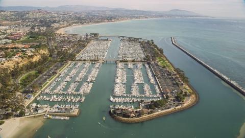 AX0159_192.0000307 - Aerial stock photo of Boats docked at Dana Point Harbor in Dana Point, California