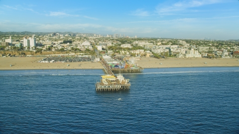 AX0161_079.0000129 - Aerial stock photo of Santa Monica Pier and beach seen from the ocean, Santa Monica, California
