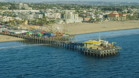 AX0161_081.0000286 - Aerial stock photo of Tourists walking on Santa Monica Pier in Santa Monica, California