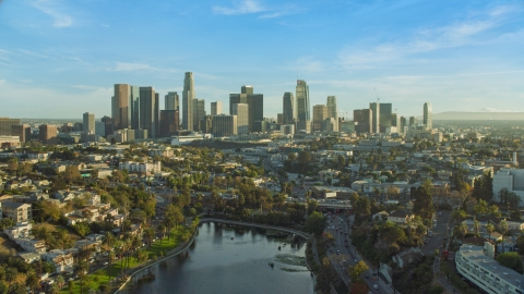 AX0162_001.0000318 - Aerial stock photo of The skyline of Downtown Los Angeles, California seen from Echo Park Lake