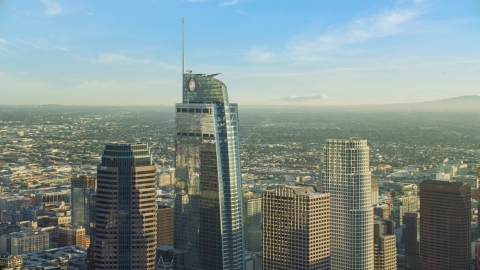 AX0162_013.0000070 - Aerial stock photo of The Wilshire Grand Center skyscraper in Downtown Los Angeles, California