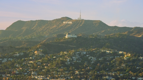AX0162_045.0000068 - Aerial stock photo of The Hollywood Sign behind Griffith Observatory in Los Angeles, California