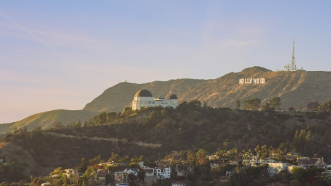 AX0162_052.0000333 - Aerial stock photo of Griffith Observatory with the Hollywood Sign in the background in Los Angeles, California