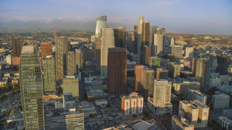 AX0162_070.0000088 - Aerial stock photo of Skyscrapers at sunset in Downtown Los Angeles, California
