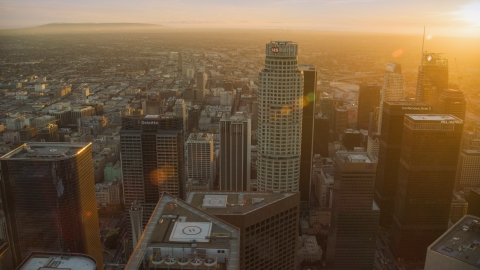 AX0162_082.0000322 - Aerial stock photo of US Bank Tower and skyscrapers at sunset in Downtown Los Angeles, California