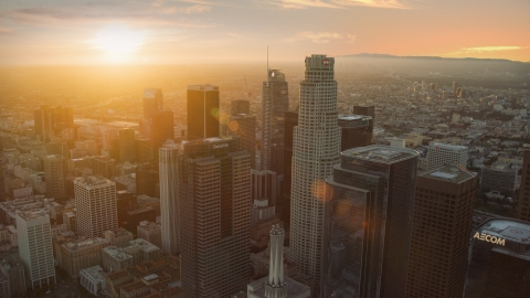 AX0162_083.0000312 - Aerial stock photo of US Bank Tower and nearby skyscrapers at sunset in Downtown Los Angeles, California
