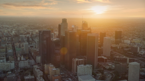 AX0162_086.0000142 - Aerial stock photo of The tall towers of downtown at sunset in Downtown Los Angeles, California